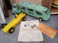 Vintage Tonka car hauler, Comet Boland AP Special race car and Hot Wheels car missing one tire