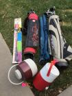 2 water jugs, CocaCola fishing pole NIB, various golf clubs and 2 versa-brellas