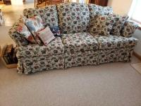 3 cushion 6' sofa by Justice Mfg. Co, Lebanon, MO and magazine rack with empty photo albums. Pillows also included