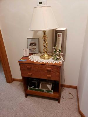 Entry table w 2 drawers and lower shelf with all contents including picture frames, brass tone lamp, framed artwork and hummingbird figurine