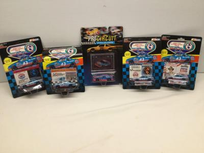 4 Richard Petty Racing Champions collectors limited edition stock cars and 1 Hot Wheels Pro Circuit collector car All with collector cards and stands