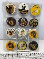 12 IA Hawkeyes homecoming badges-1975, 1977, 1978,  1979, 1980, 1981 (2 of the same), 1982 (2 of the same), 1983, 1984, 1986