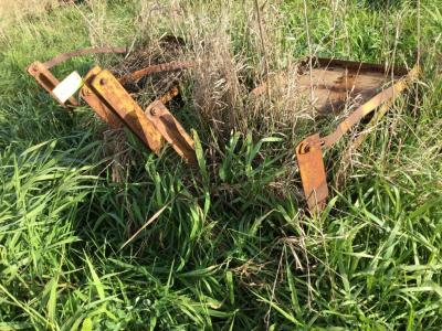 3 pt hitch 2 row rotary hoe. We are sorry about the pictures, we can't see through the grass either
