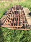 4 approximately 12' long hog pipe gates. Trailer not included.