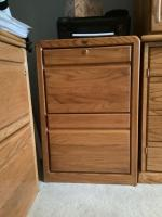 "Encore oak 2 draw filing cabinet letter size. Measures 19""L x by 25""W x by 30""H  Does come with a key"