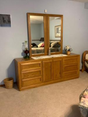 "Thomasville six drawer dresser with cabinet that includes three additional ""hidden"" drawers and mirror. Dresser measures 74 x 18 x 30 and the mirror measures 46 x 44. *No contents*"