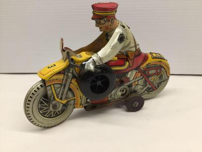 Tin wind up motorcycle rider