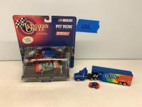 Jeff Gordon Winners Circle Pit Row Series car and pit crew in original packaging and Jeff Gordon semi with car hauler and micro car