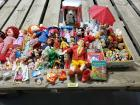 Ronald McDonald doll, Annie doll, Raggedy Ann doll, Pinocchio doll, keychains, vintage Woody Woodpecker book, Pound Puppies, CocaCola bear, many other