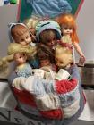 Box of vintage dolls and clothes