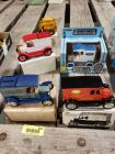 4 Ertl die cast banks and a Gehl skid loader