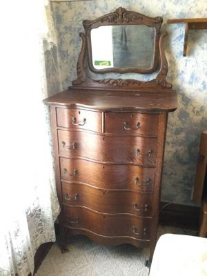 Serpentine front oak veneer highboy dresser with mirror. Measures 17 x 28 x 68 and matches the dresser in previous lot