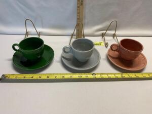 Three Teacups and Saucers