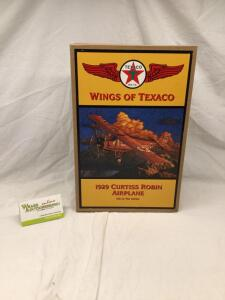 Ertl Wings of Texaco 1929 Curtiss Robin airplane, sixth in the Wings of Texaco series. In all original packaging