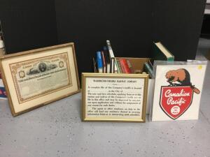 Railroad related books and artwork. The Canadian Pacific sign is cardboard