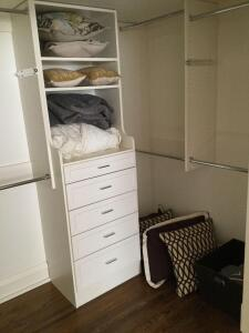 All linens in closet include blankets, decorative pillows, towels
