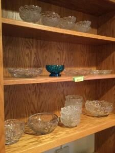 Various pieces of glassware and crystal including sherbets, serving bowls, bowls, blue comport and more