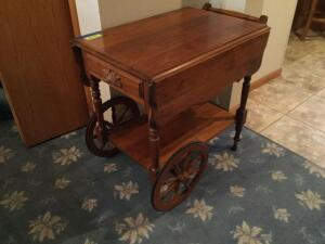Amana Walnut Krauss rolling serving cart measures 28 x 19 x 28 with two 8 inch drop leaves and drawer on one end