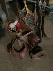 Homemade cross bow, vintage leather helmet and pads, rackets, balls, baseball glove and more