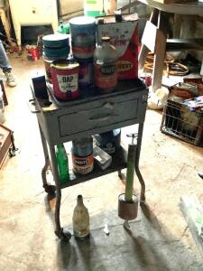 Small rolling table with vintage cans, bottles and vintage fly sprayer
