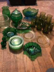 Box of green, yellow and pink depression and carnival glassware.