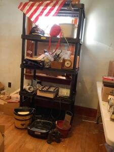 All items on shelf-West Bend electric skillet, Proctor Silex 5qt crock pot, large 3 wick candle, work light, binders, caps, Boy Scouts water canteen, ice cream machine and much more **Shelf excluded**
