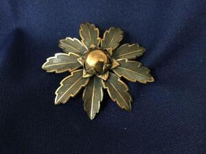 "Brooch marked ""Solid Copper"""