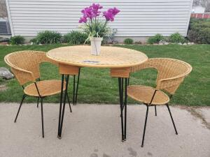 Wicker table with coordinating chairs. 3 ft. diameter