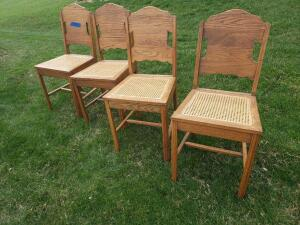 Four beautiful cane seat straight back chairs.