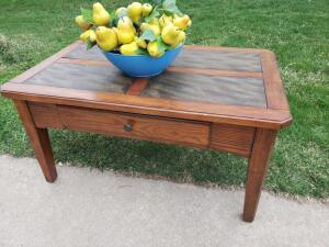 Coffe table with slate style inlay, middle drawer and bowl of pears