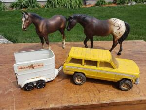 Beautiful vintage horses, but they need a bigger Tonka Jeep and Tonka trailer.