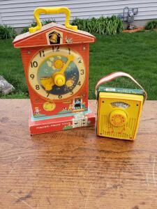 Classic Fisher Price clock and radio, the Bose stereo for babies back in the day.