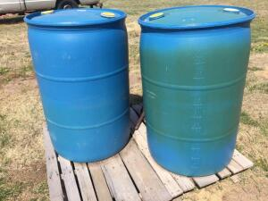 Two 55 gallon plastic has barrels (each approximately 1/4 full-one Diesel, one regular)