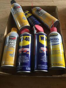WD-40 spray cans and Johnson's lubricant sealer