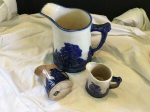 Sleepy Eye pitcher and 2 handled mugs See photos-there are some cracks