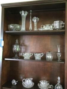Contents of bookcase includes glassware-candy dishes, vases, cruet, cream & sugar, china and more so be sure to see all photos