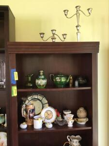 Contents of shelf include weighted sterling candleholders, handpainted glassware, Warwick China, large fork and spoon, bamboo rug beater, presidents pitcher See all photos
