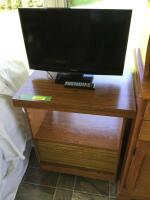 "Rolling TV stand measures 24 x 19 x 31 with 23"" Samsung flat screen television and remote"