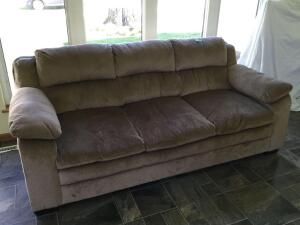"Three cushion living room sofa, measures 83""L and is tan colored"