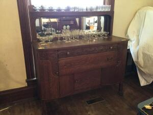 Mirror backed hutch with two drawers and side door storage and lower storage. Cabinet does have casters that are not attached and does need minimal el