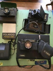 Vintage cameras-Polaroid flash gun number 268, Polaroid Instamatic camera, two Yashica Electro 35 cameras, Brownie and folding pocket Kodak