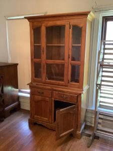 China hutch with single door glass front, double door lower storage and two drawers. It measures 42 x 17 80 and is two pieces for easy moving