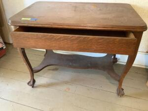 Vintage library table with single drawer measures 40 x 25 x 31 with casters