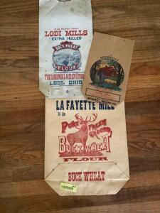 Three paper feed sacks-Lodi Mills, Brumwells, and Lafayette Mill