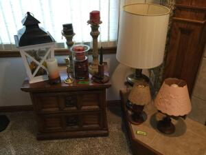Two drawer nightstand, candleholders, table lamps. Nightstand measures 26 x 14 x 23.