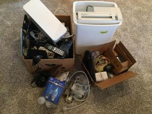Electronic items – paper shredder, surge protectors, phones, small student lamp, alarm clocks, headphones and earbuds, lightbulbs. See photos