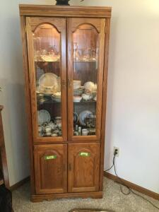 Lighted glass front double door cabinet w double door lower storage Measures 35 18 x 75. No contents included
