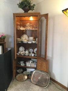 All glassware and china in cabinet – stemware,china plates, cream and sugar, vases, cups, plate holders, tea pots, real neat candle holder with match stick holder, silverplate serving tray and glass dresser tray