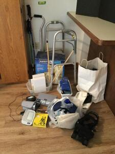 All medical items-walker, walking sticks, canes, ice packs, braces, Omron blood pressure monitor,  Safety First toilet seat