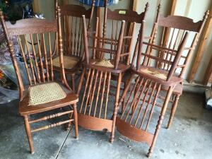 Six matching spindle back dining chairs with cane seats. Some of the seats do need repair. See photos